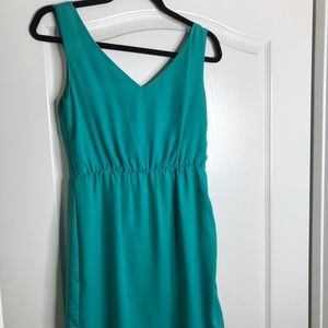 Green mini dress with low back